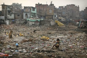 An Indian boy defecates in the open, New Delhi, India